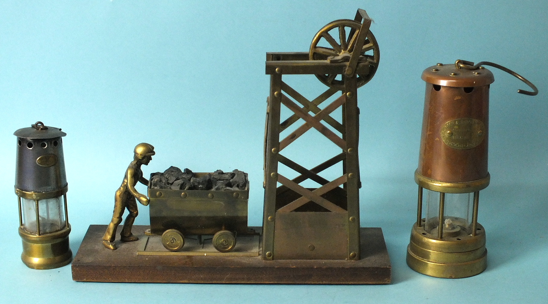 Lot 606 - A brass model of a colliery and figure pushing a wagon of coal, a Hockley Lamp & Limelight Co.