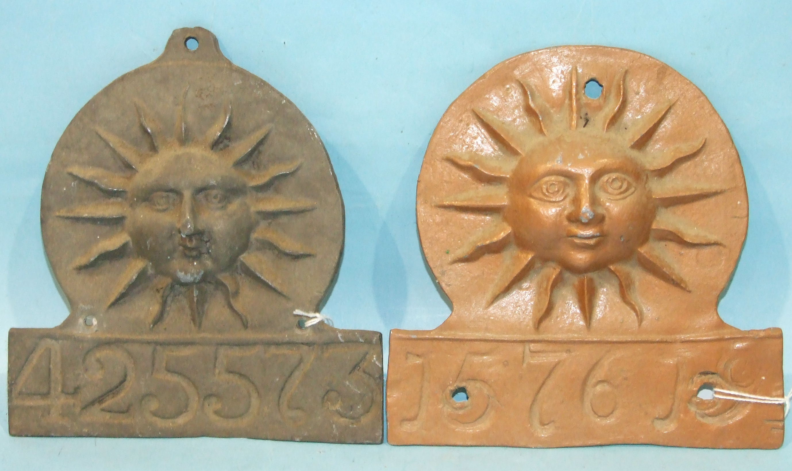 Lot 608 - A Sun Alliance lead fire mark numbered 425573, 18cm x 17cm and another, painted, numbered 157619, 18