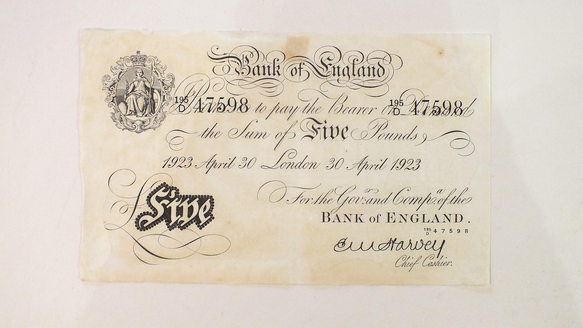 Lot 177 - A Bank of England pre-1925 black and white £5 note April 30 1923 195/D 47598, cashier E. M.