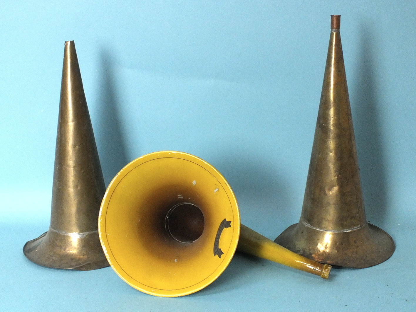 Lot 539 - Excellaite, a painted cast metal and aluminium swan-neck horn, 26cm and two brass horns, 25cm, (3).