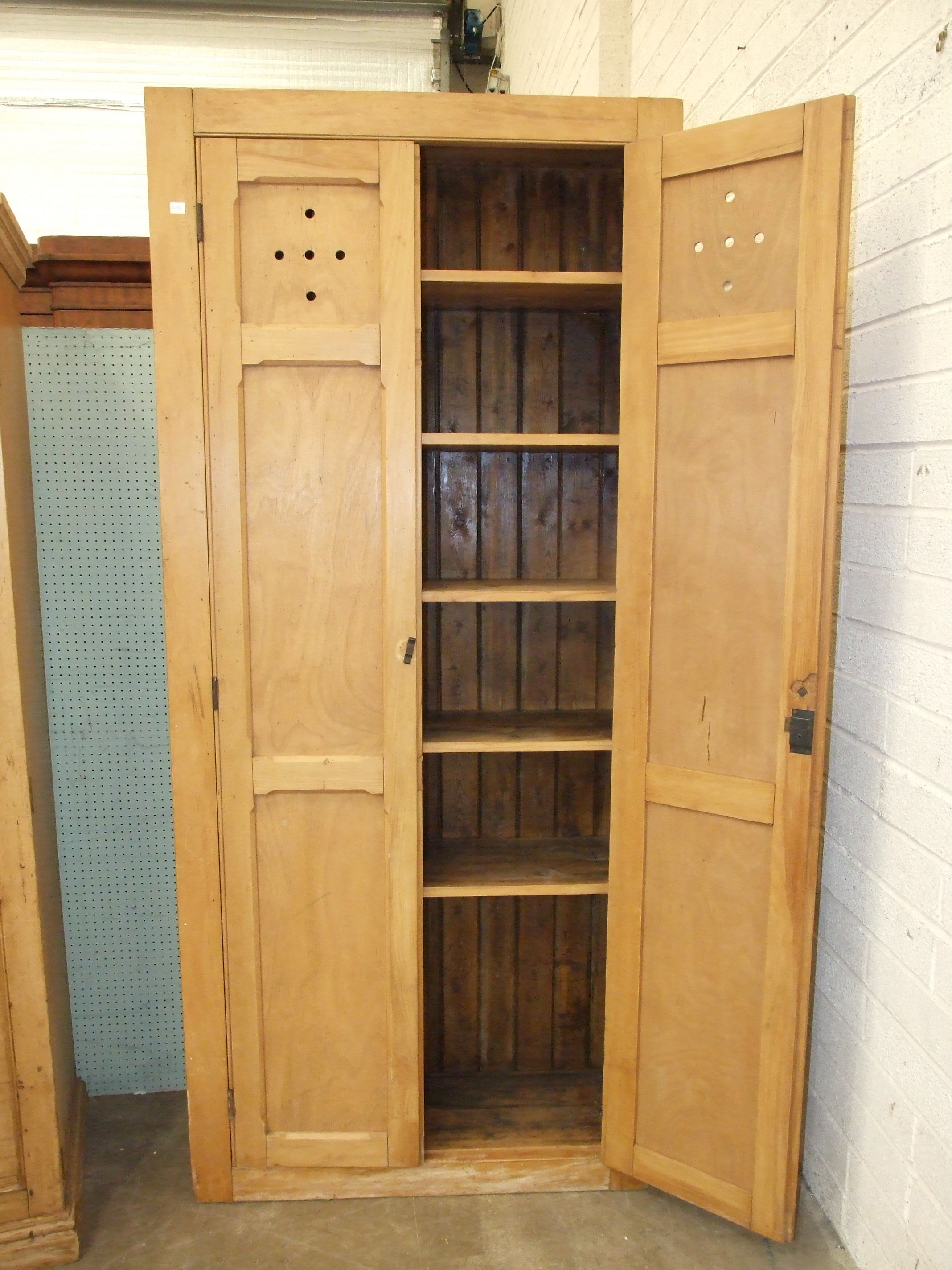 A tall stripped pine two-door larder cupboard with shelved interior, 97cm wide, 220cm high. - Image 2 of 2