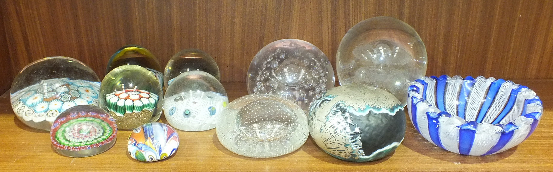 Lot 66 - A collection of millefiori and plain glass paperweights, an oval blue and white lattice-work glass