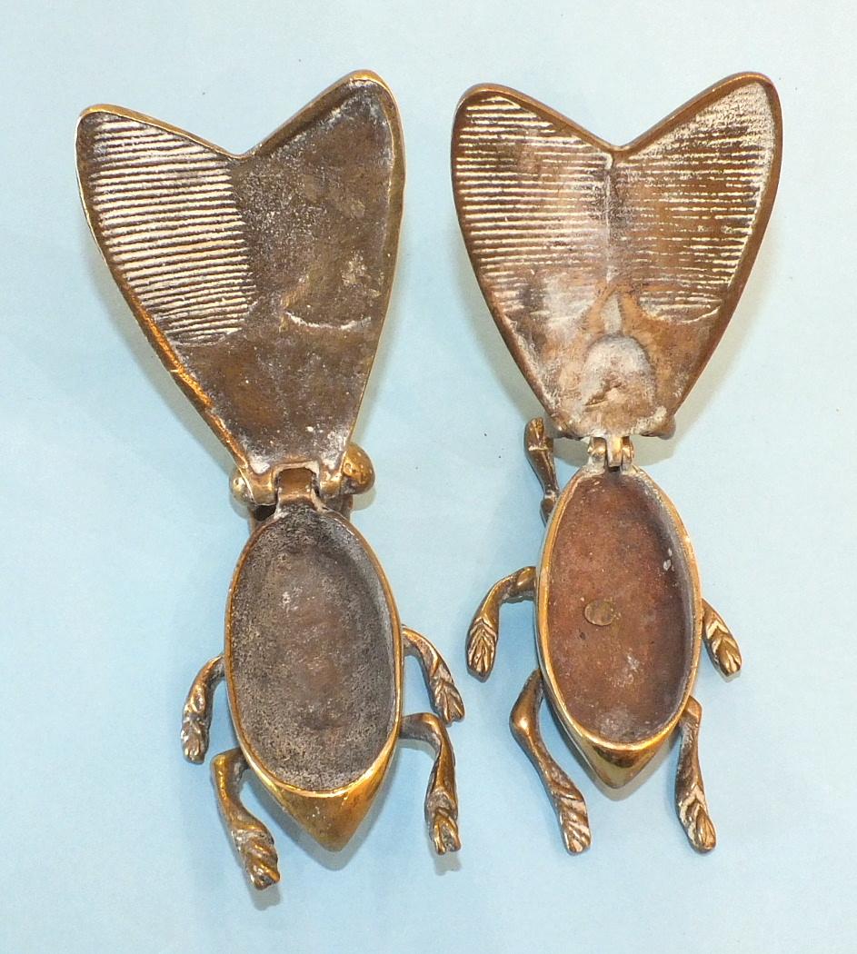 Lot 137 - Two novelty brass desk Vestas modelled as flies, 9cm long, (2).