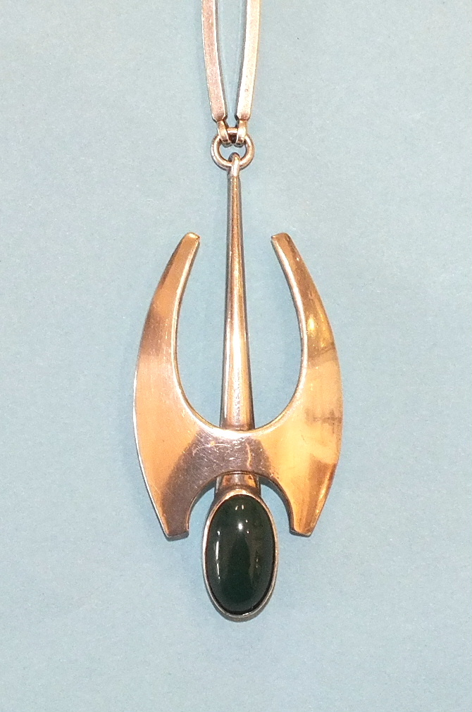 Lot 241 - A Danish sterling silver necklace by N E From, of modernist design c1973, the pendant set green