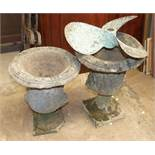 Two concrete garden urns, 50cm high, a bronze propeller and a small wooden rocking horse, (a/f), (