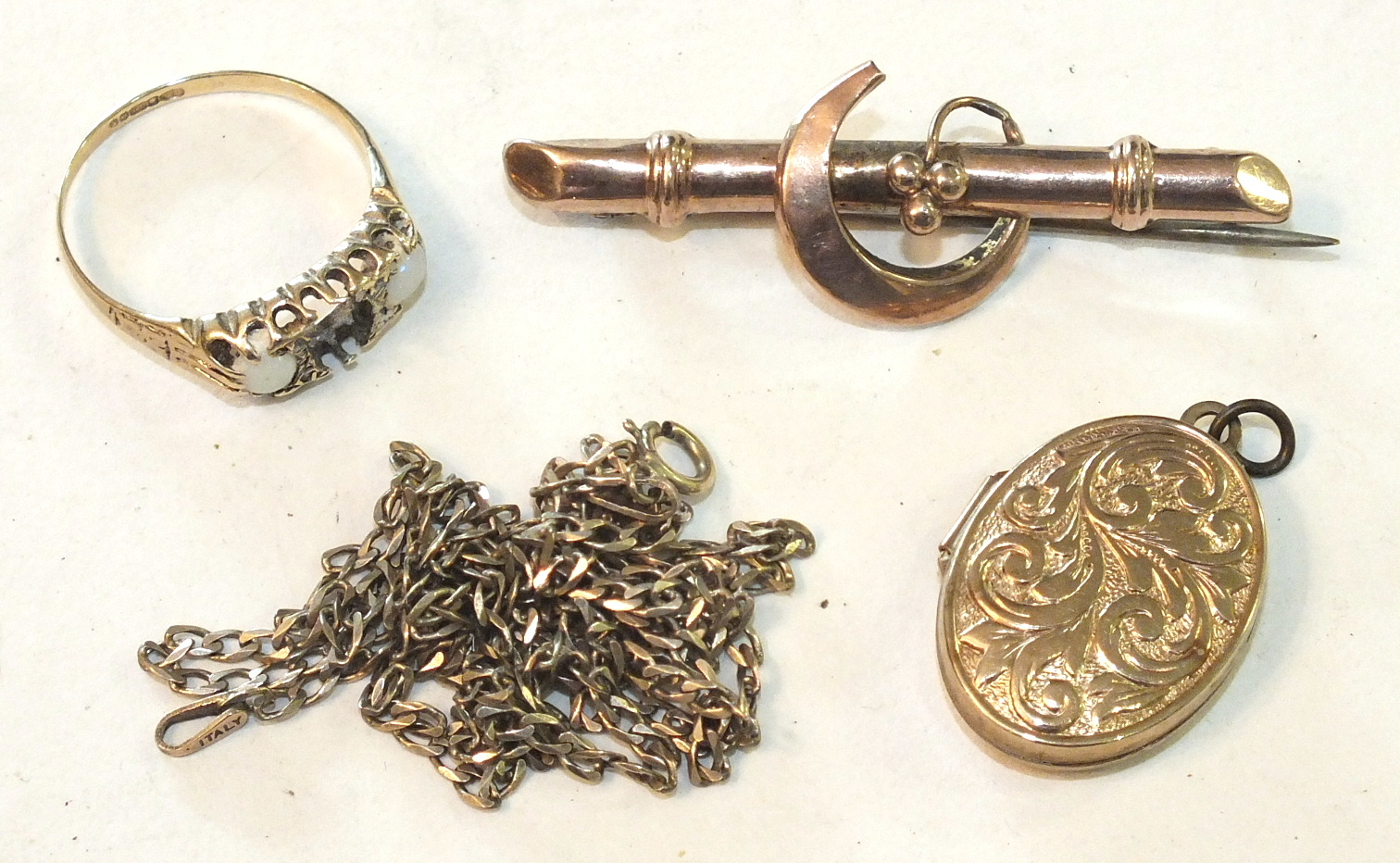 Lot 299 - A 9ct gold brooch, a gold locket on chain and a ring, (a/f), 8.3g, (3).