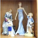 A group of four Royal Doulton figurines, 'Dorothy' HN3098, 'Little Boy Blue' HN2062, 'Special