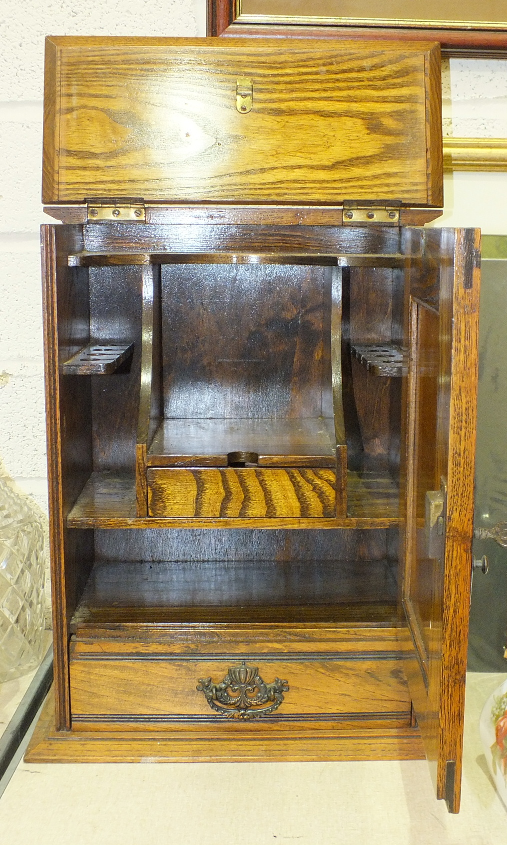 A smoker's small compendium cabinet, the door with Art Nouveau-style copper panel enclosing a fitted - Image 2 of 2