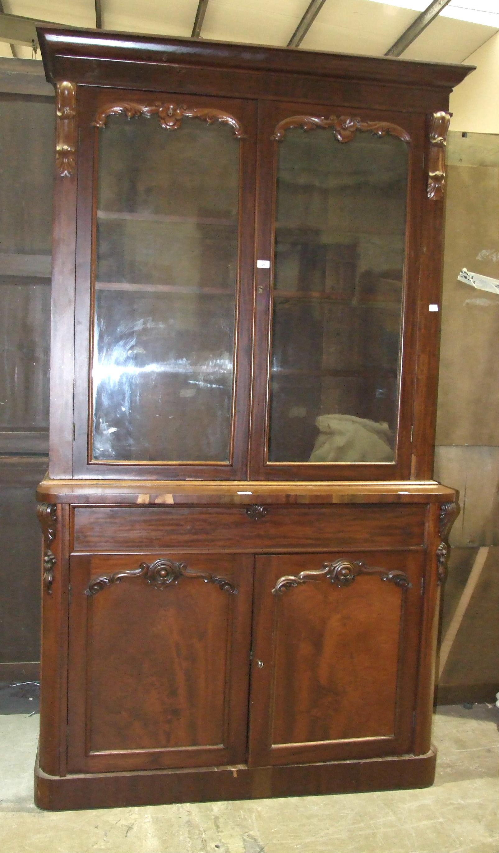 A Victorian mahogany bookcase, the cornice above a pair of glazed doors, a drawer and cupboard - Image 2 of 2