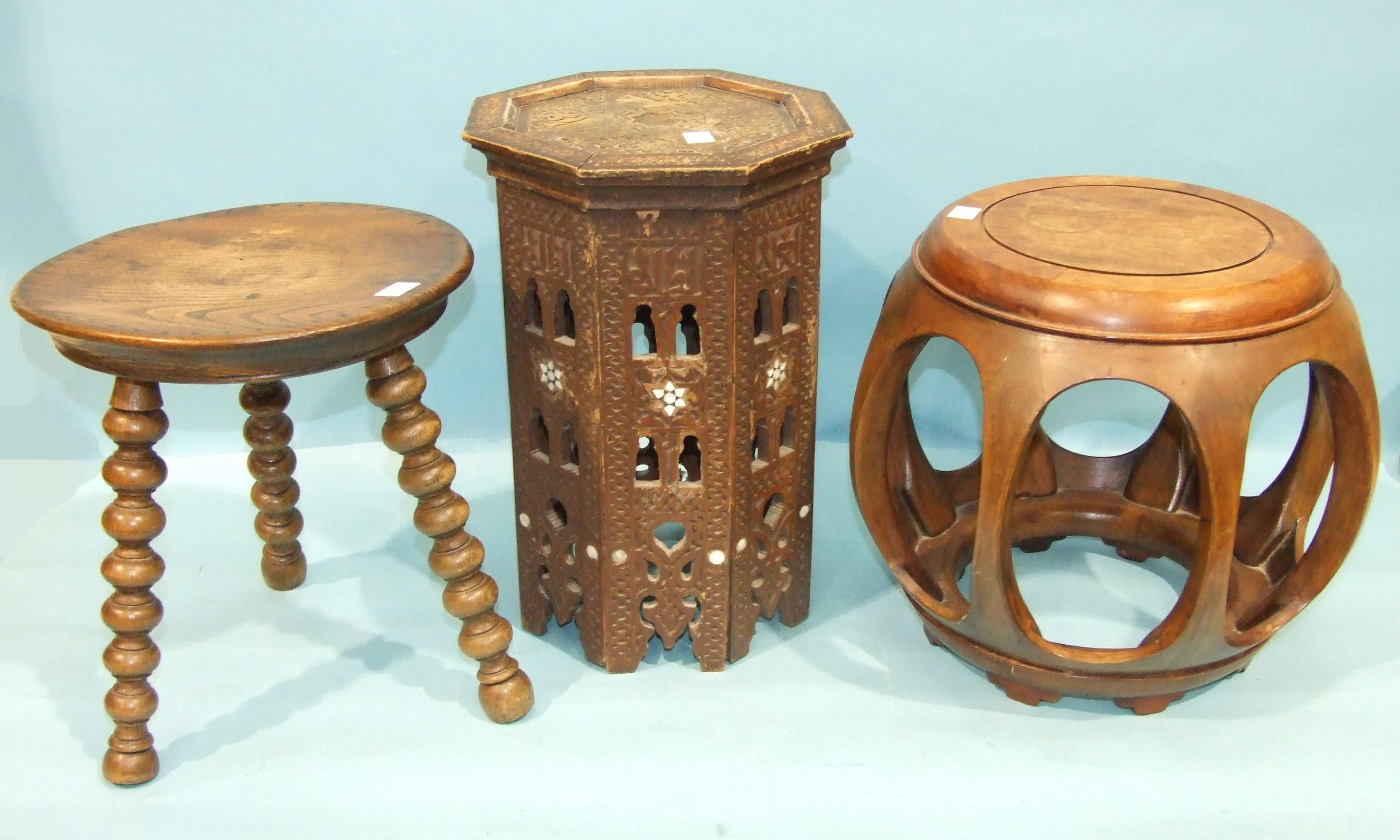 An Oriental hardwood jardinière stand of pierced barrel shape, 38cm wide, 36cm high and other