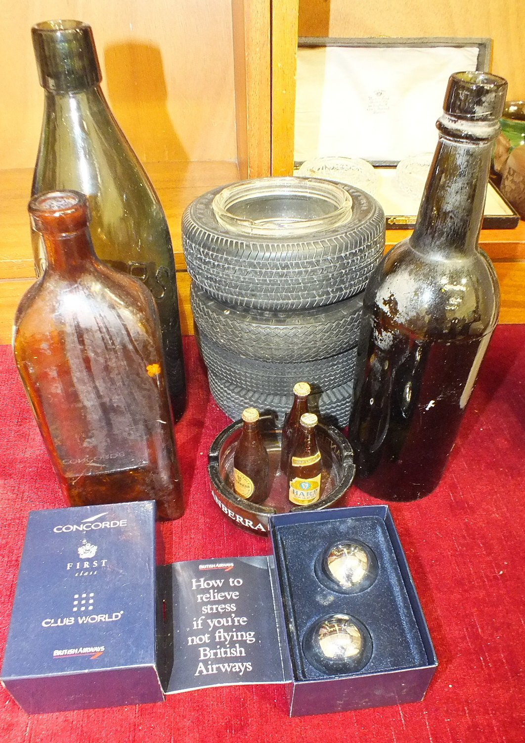 Lot 170 - Four 'Goodyear' advertising tyre ashtrays, three miniature advertising bottles, (2 x Guinness, 1 x