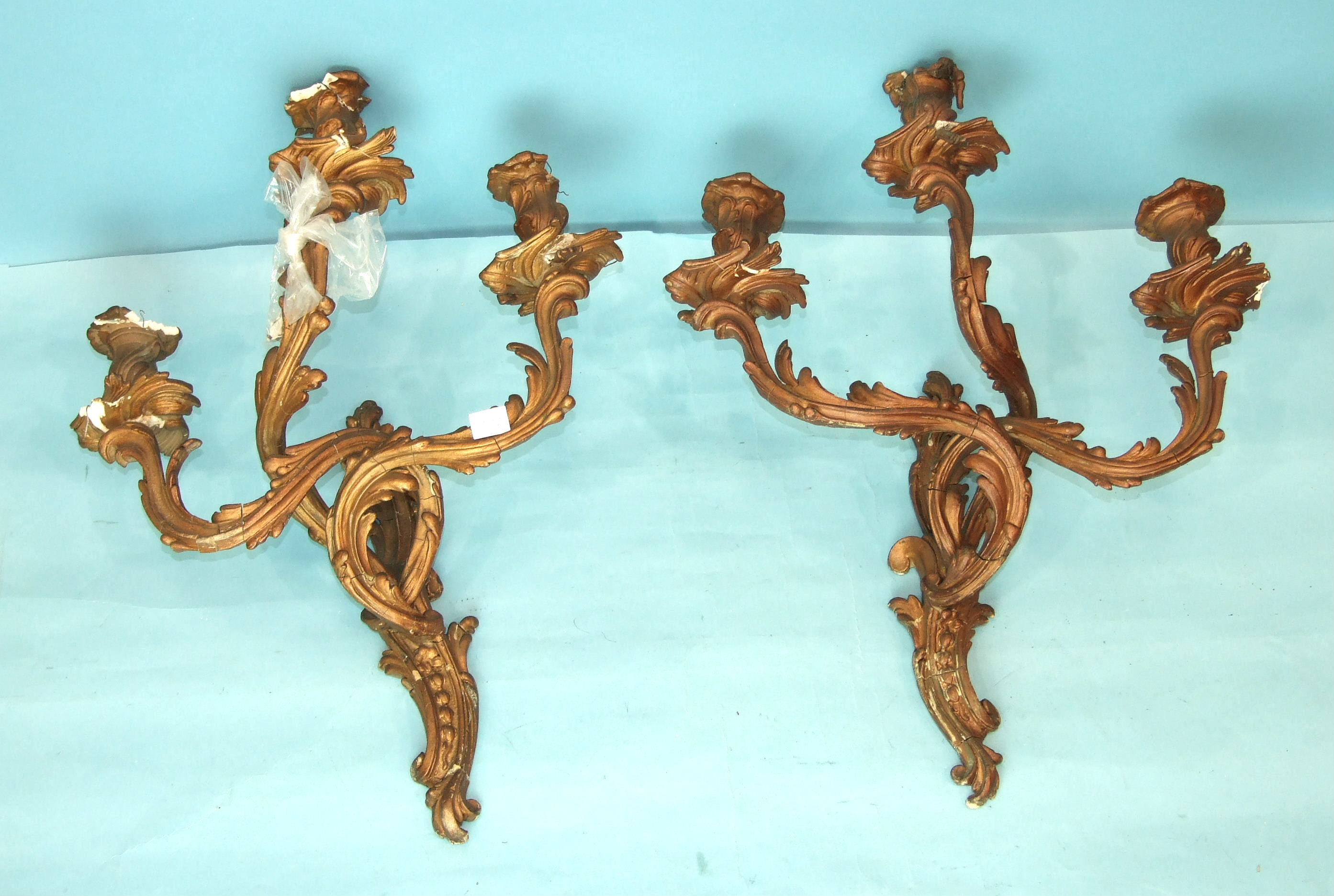 Lot 127 - A pair of gesso three-branch wall-mounted candle holders, an inlaid walnut over-mantel mirror, 71