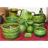 A group of green-glazed pottery jugs, bowls and vases, 14 pieces.