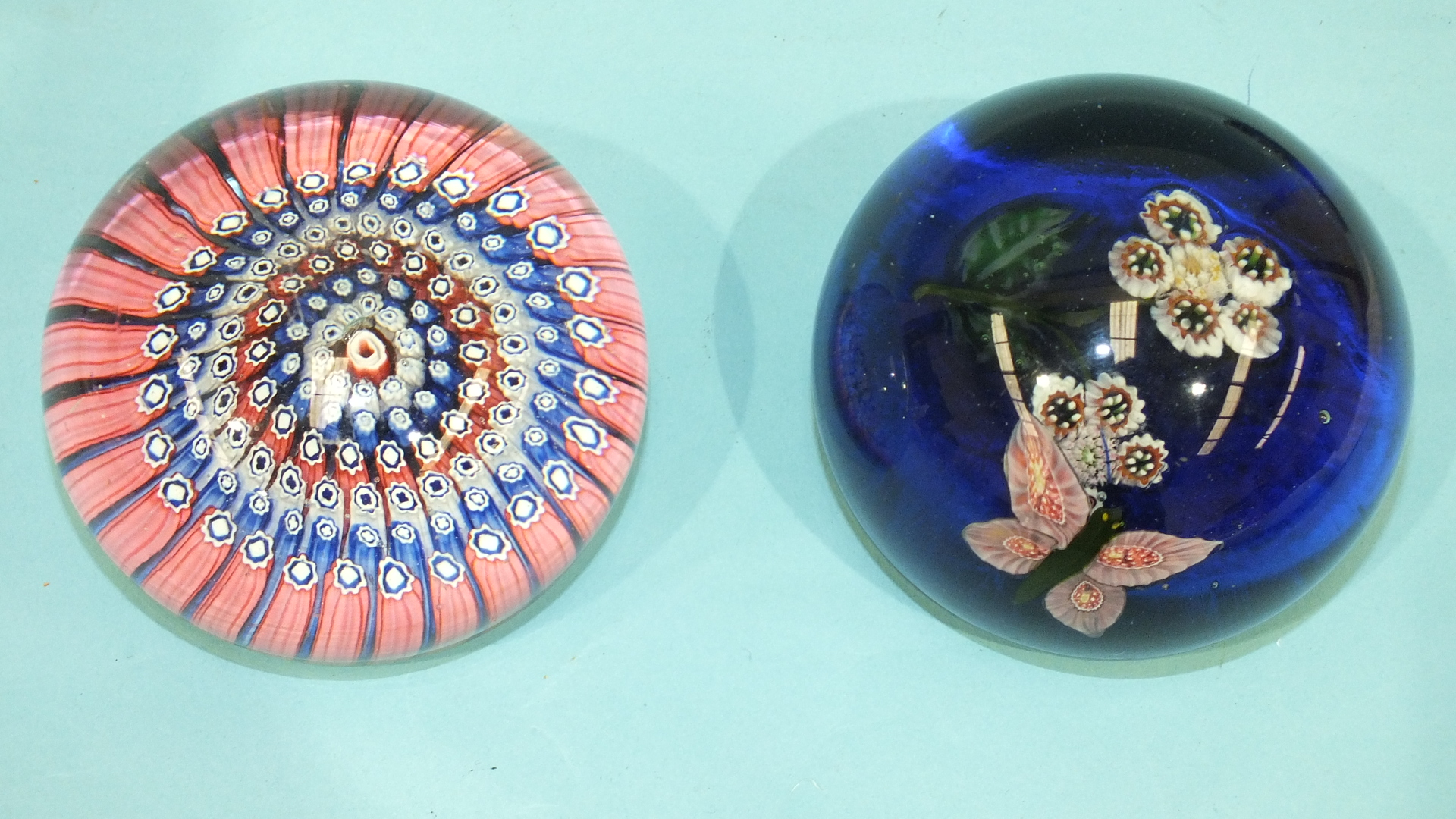 Lot 254 - A modern unmarked glass paperweight decorated with a butterfly and flowers and one other