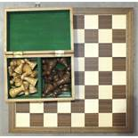 A similar modern Staunton-style chess set in fitted box and a modern chess board, 45cm square.