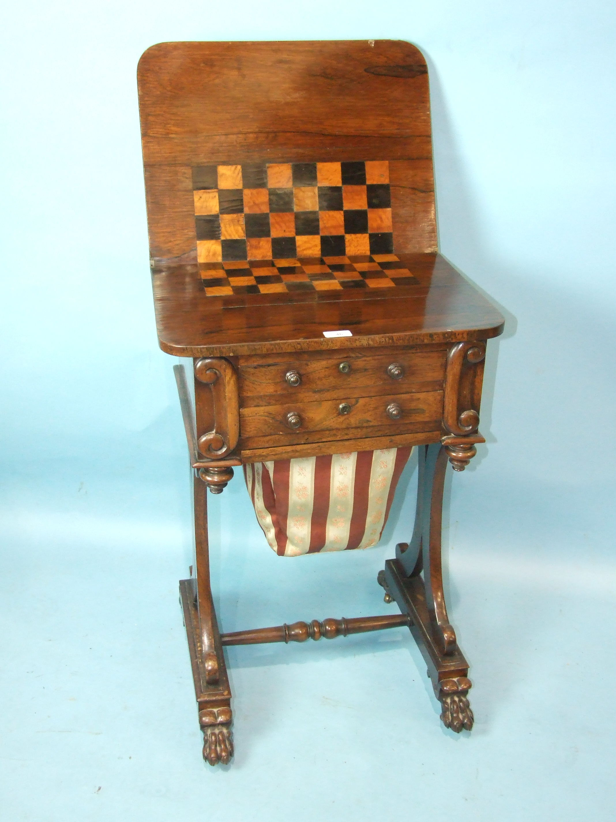 An early-19th century rosewood games and work table, the folding swivel top with satinwood and ebony - Image 2 of 2