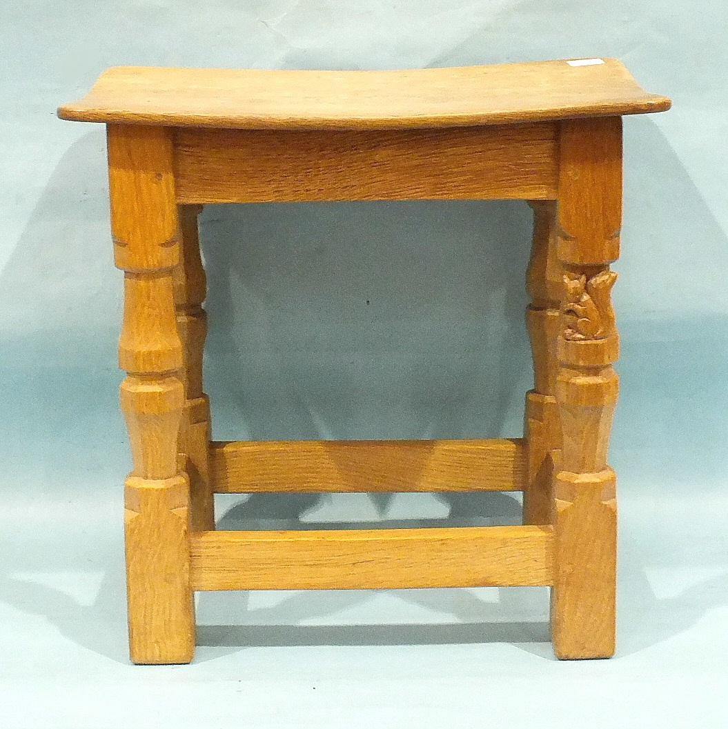 Wilf (Squirrelman) Hutchinson, an oak stool, the shaped seat on carved and turned legs joined by