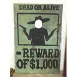 A large fairground 'Face-in-Hole' board painted 'DEAD OR ALIVE', over silhouette of a bandit and '