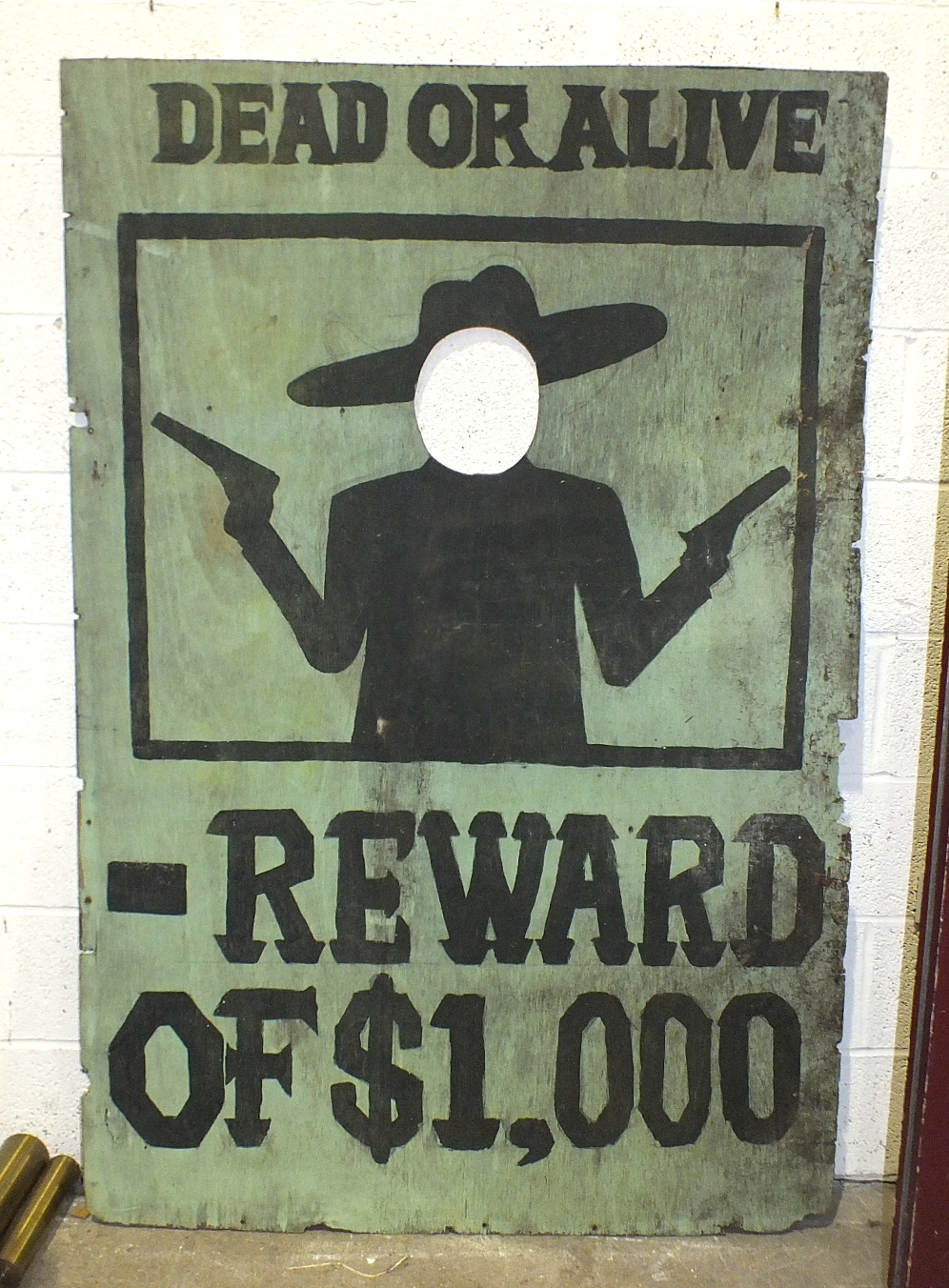 Lot 87 - A large fairground 'Face-in-Hole' board painted 'DEAD OR ALIVE', over silhouette of a bandit and '