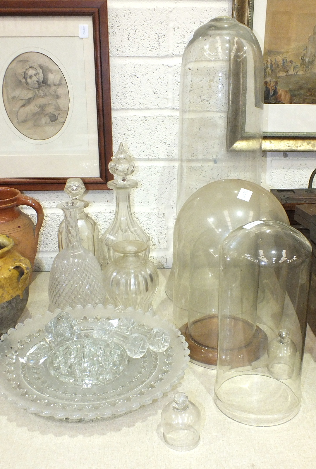Lot 39 - Three glass domes, three cut-glass decanters and other glassware.