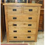 A modern oak chest of two short and four long drawers, 98cm wide, 120cm high.