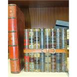 A Huntley & Palmers novelty biscuit tin in the form of bound books, 16cm, other advertising tins and