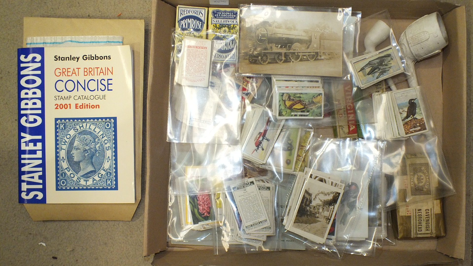 Lot 236 - A small collection of cigarette and trade cards, postcards, etc.