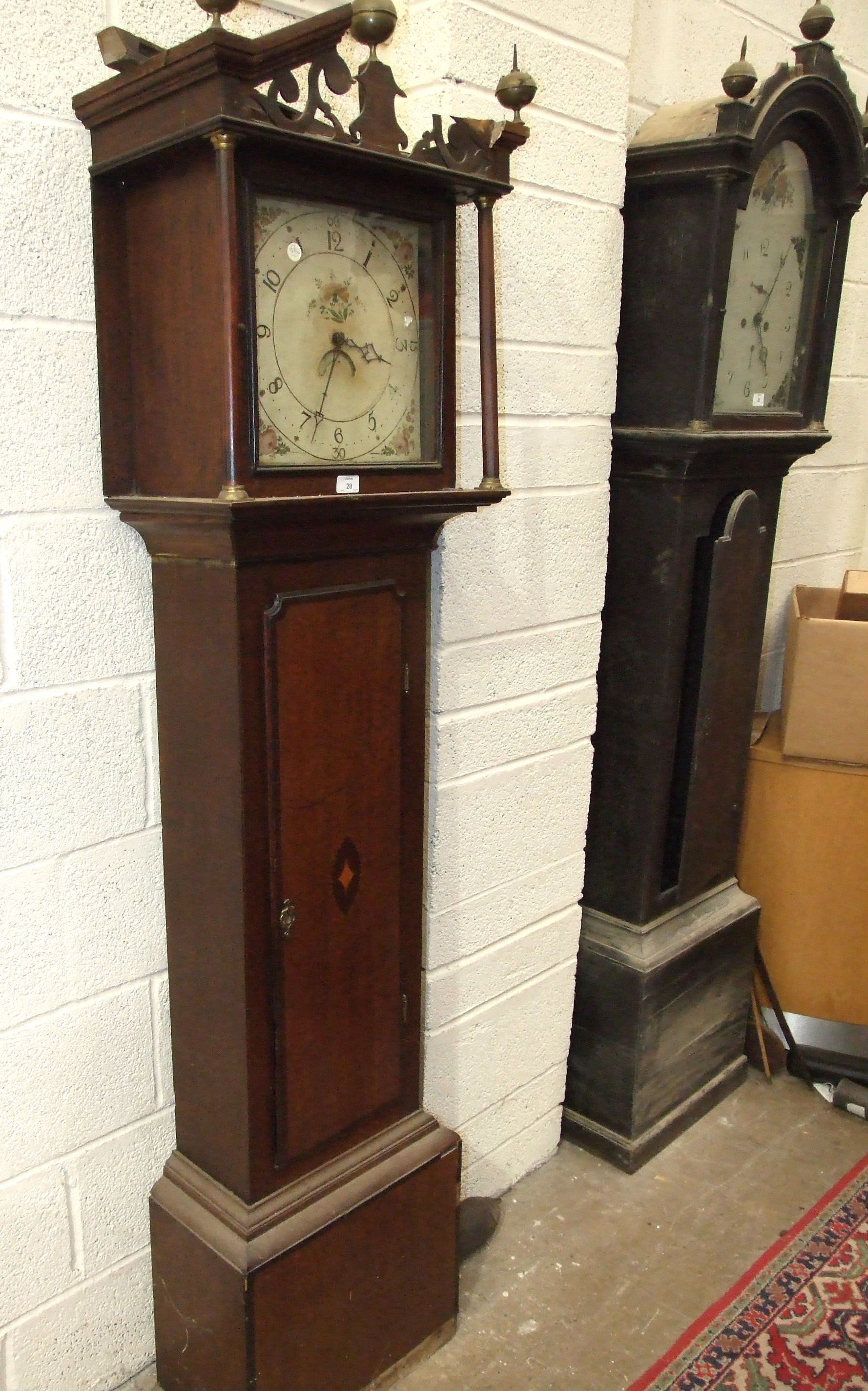 A 19th century mahogany long case clock with painted arched dial and bell-striking twin-train