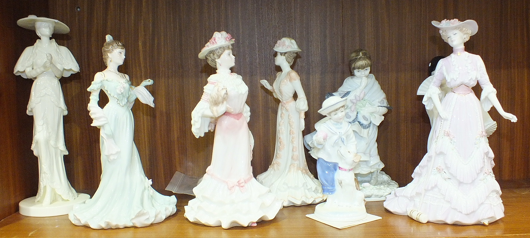 A collection of Coalport figurines, including 'High Society' and 'John Bromley', (some damages), (