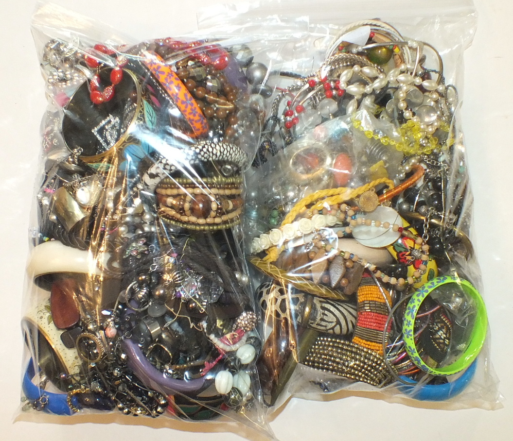 Lot 277 - A quantity of costume jewellery, the contents of two bags.
