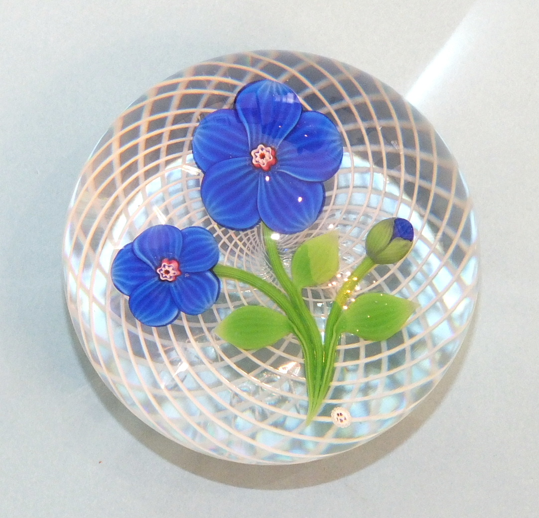 Lot 252 - A modern limited-edition Baccarat glass paperweight decorated with deep blue flowers, etched '38/