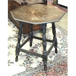 A 20th century oak octagonal occasional table on turned legs and a brass pierced fire kerb, (2).