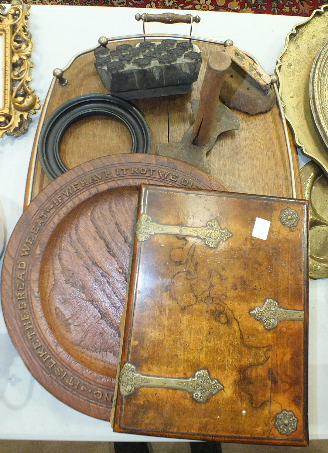 Lot 112 - A Victorian walnut and metal-bound book or blotter cover, 31 x 23cm, a carved bread dish with border