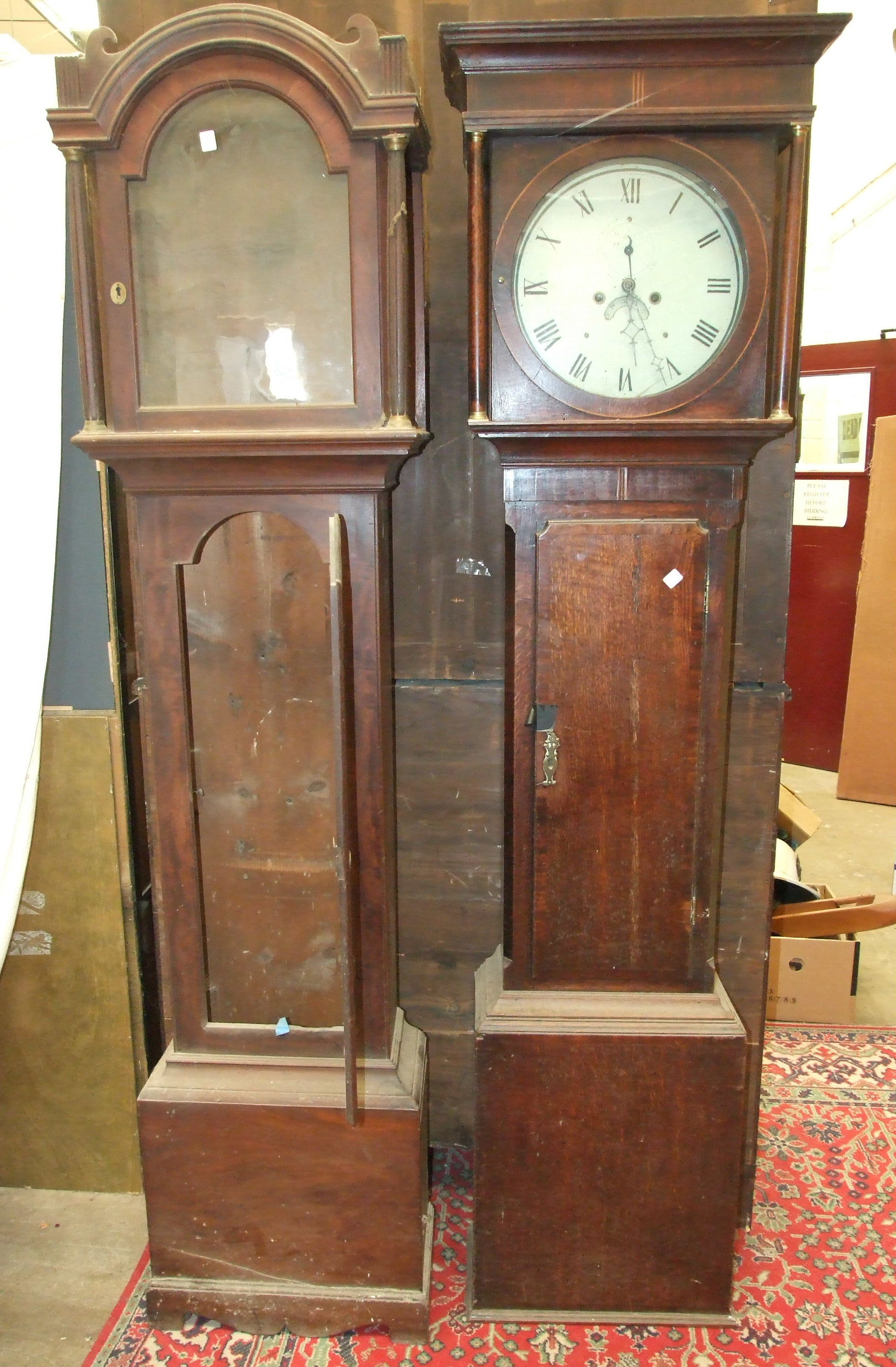 A 19th century oak and mahogany-banded long case clock with circular painted dial and twin-train