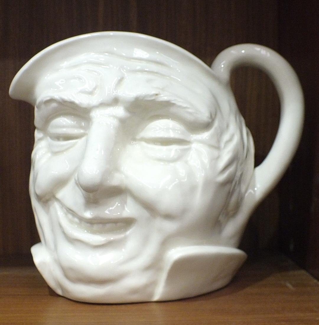 A Royal Doulton white-glazed character jug 'Farmer John', 15.5cm high.