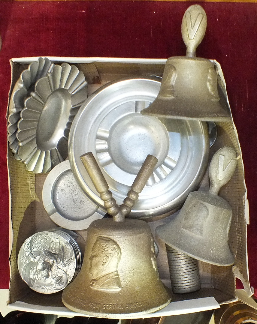 Lot 179 - Three RAF Benevolent Fund bells cast in metal from German aircraft, two aluminium ashtrays moulded