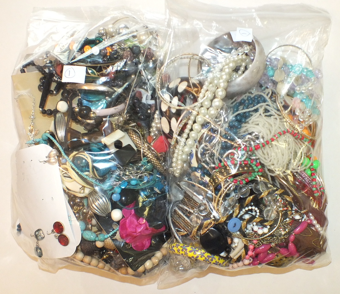 Lot 276 - A quantity of costume jewellery, the contents of two bags.