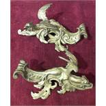 A pair of ormolu furniture mounts in the form of winged dragons, 22cm.