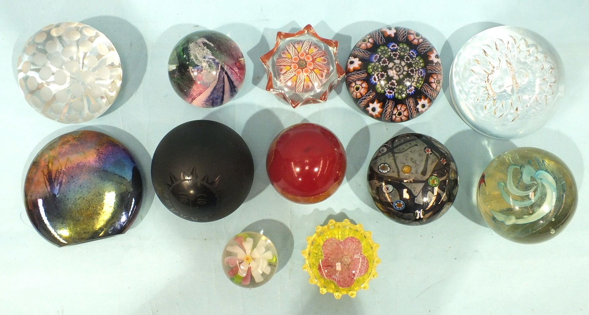 Lot 261 - A collection of twelve various modern glass paperweights, (12).