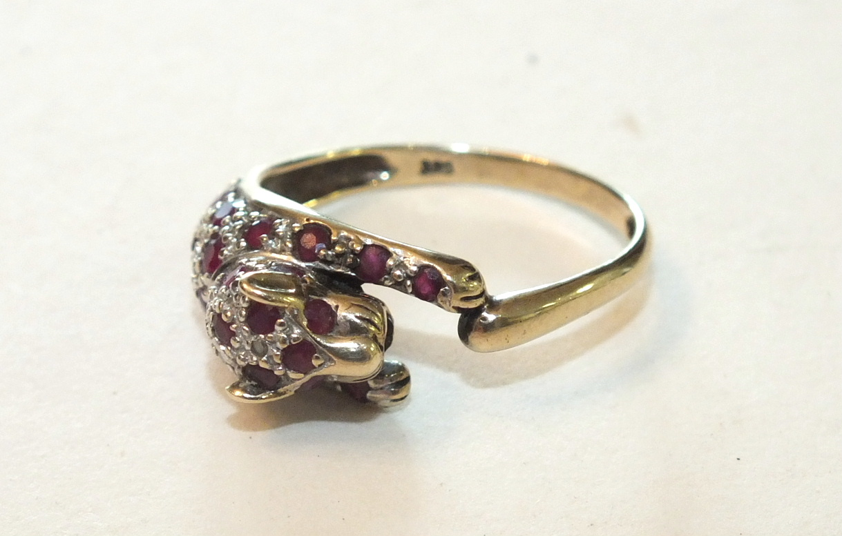 Lot 285 - A 9ct gold ring in the form of a leopard set rubies and diamonds, size O½, 2.6g.