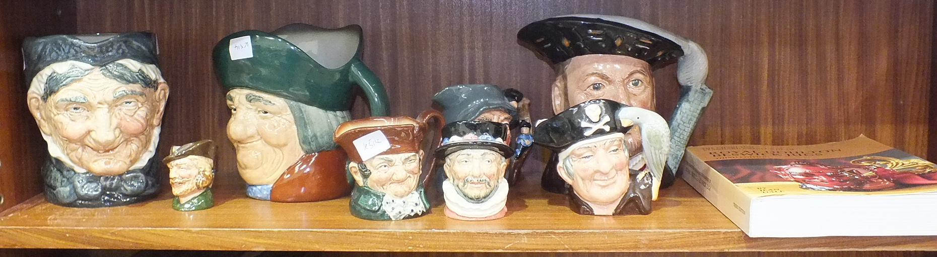 Three Royal Doulton character jugs, 'Henry VIII', 'Toby Philpots' and 'Granny' (with tooth) and five