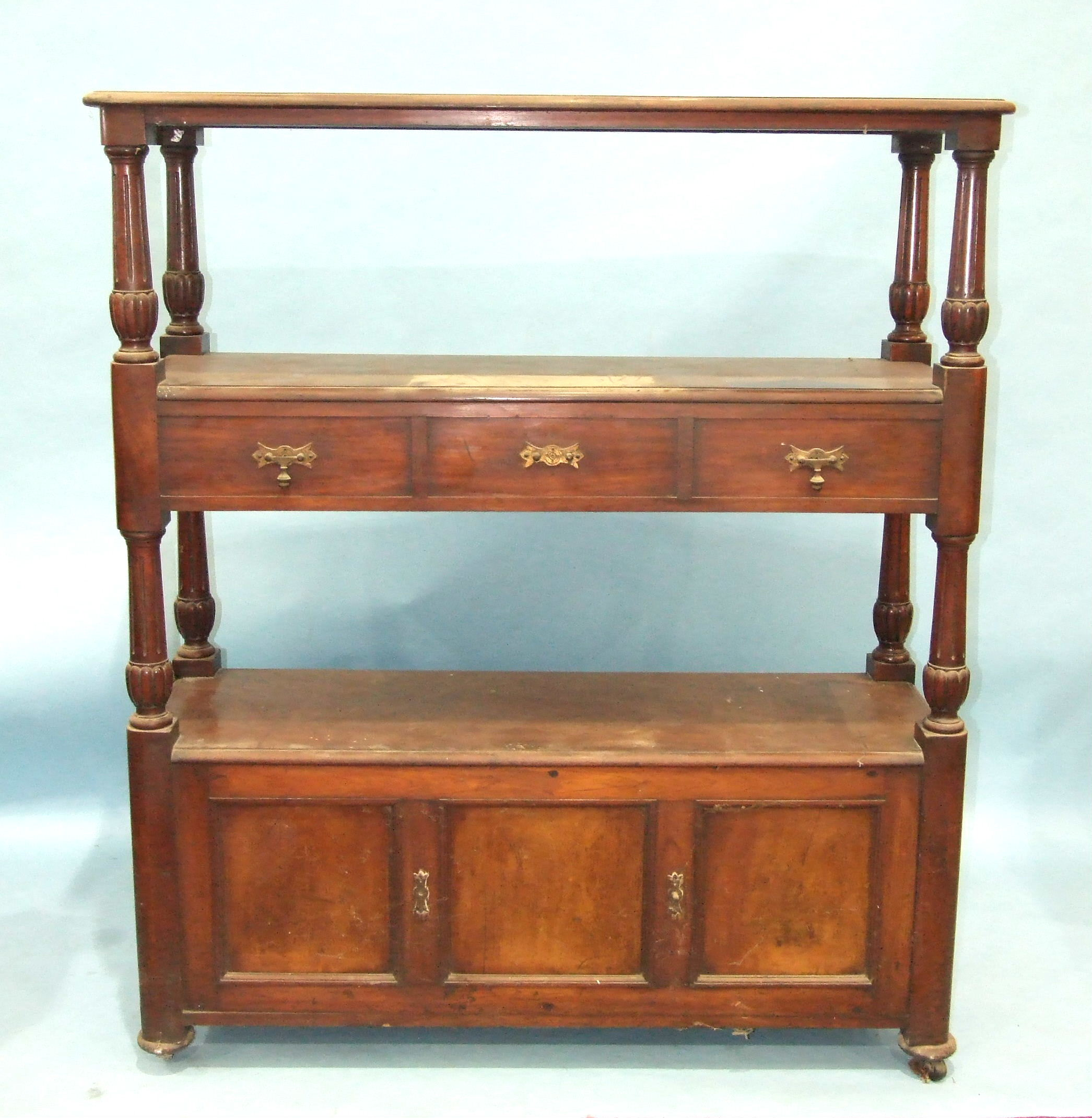 A Victorian double-sided three-tier dumb waiter, having two centre drawers and three base