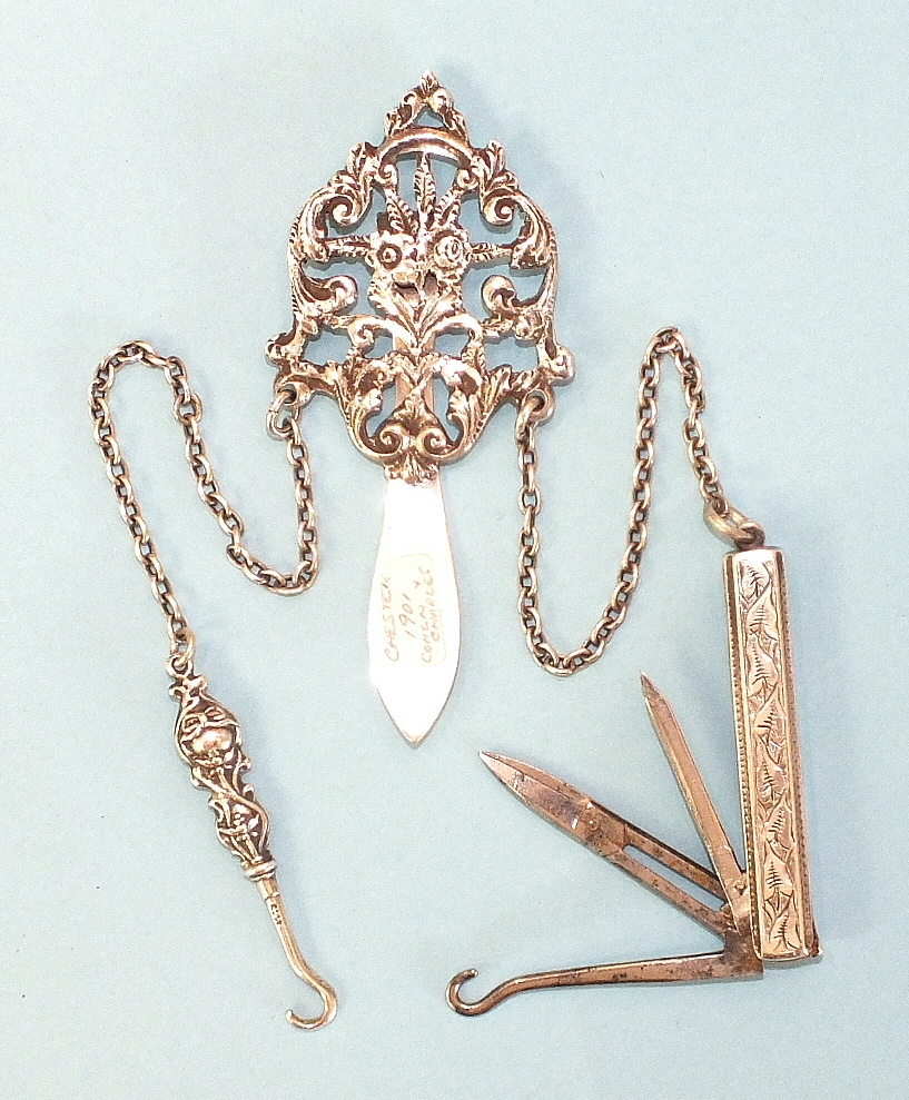 Lot 172 - An early-20th century silver chatelaine of pierced floral form, by Colen Hewer Cheshire, Chester