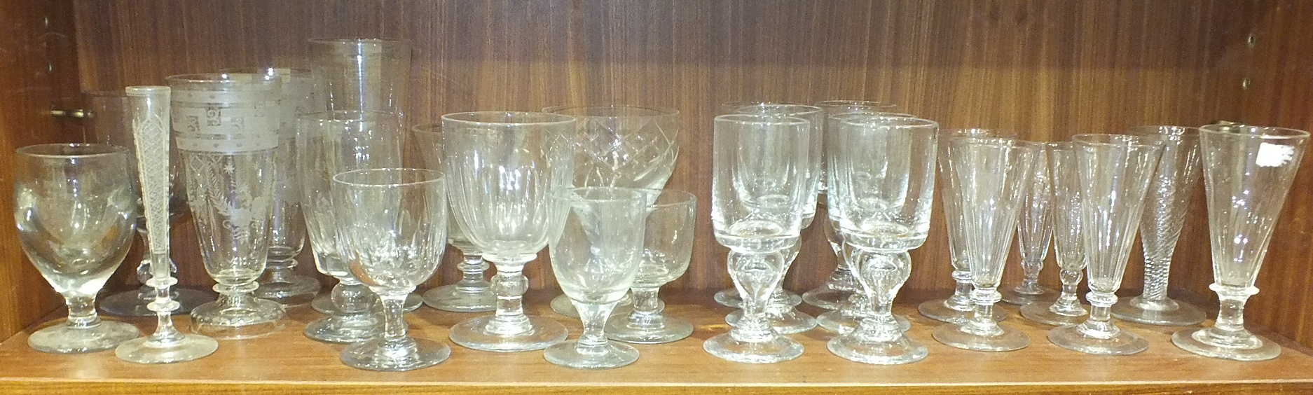 Lot 64 - Approximately fifty-seven mainly-19th century drinking glasses, including Champagne saucers, wine