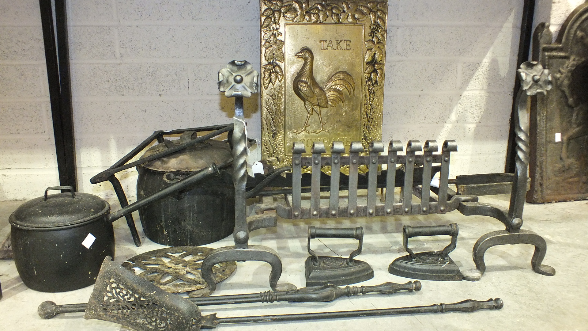 A wrought iron fire grate, dogs and fire back, together with iron cooking pots, pot hanger and