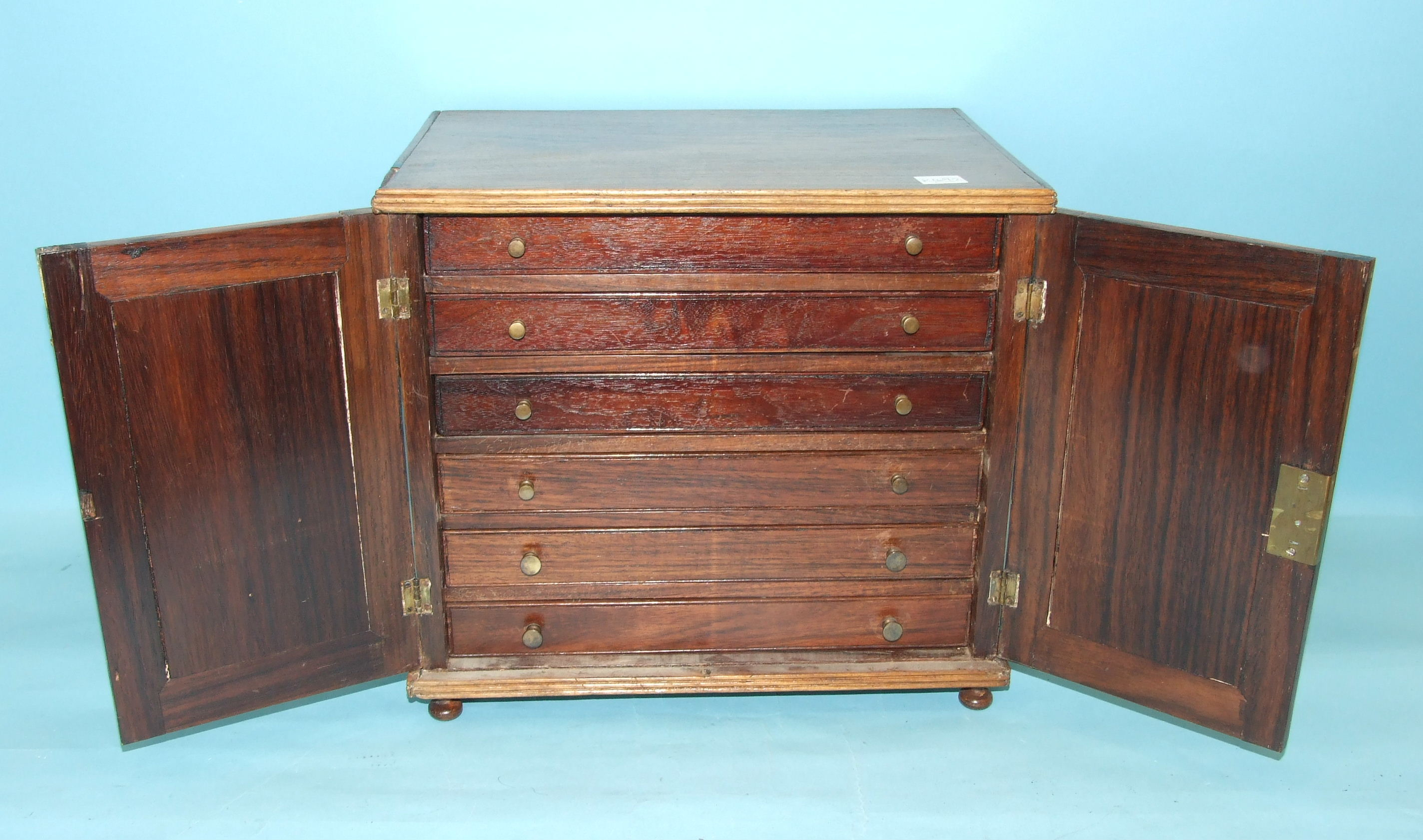 A 19th century hardwood collector's chest, having a pair of panelled doors enclosing six small - Image 2 of 2