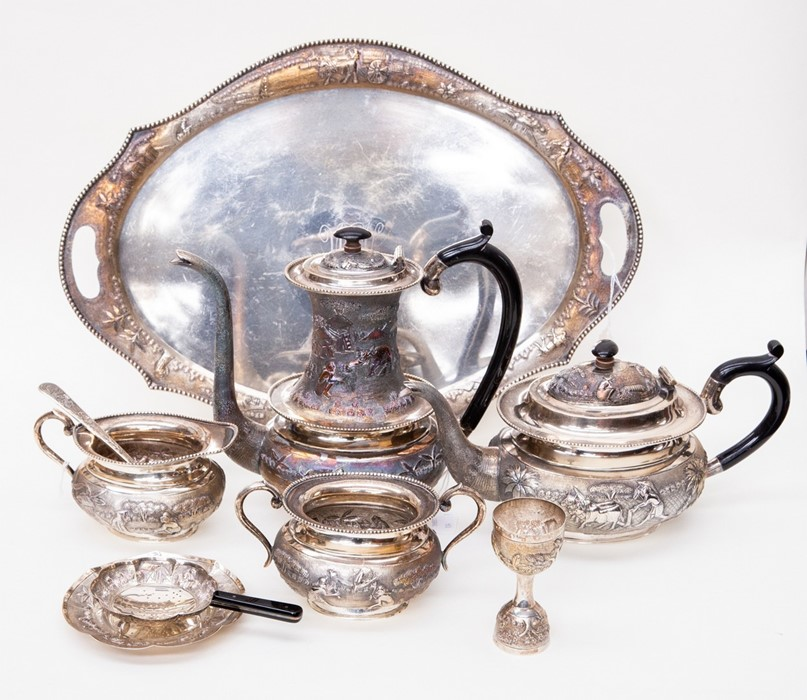 Lot 33 - Sterling silver Indian tea set, late 19th Century // Early 20th Century, tray, strainer, spoon and