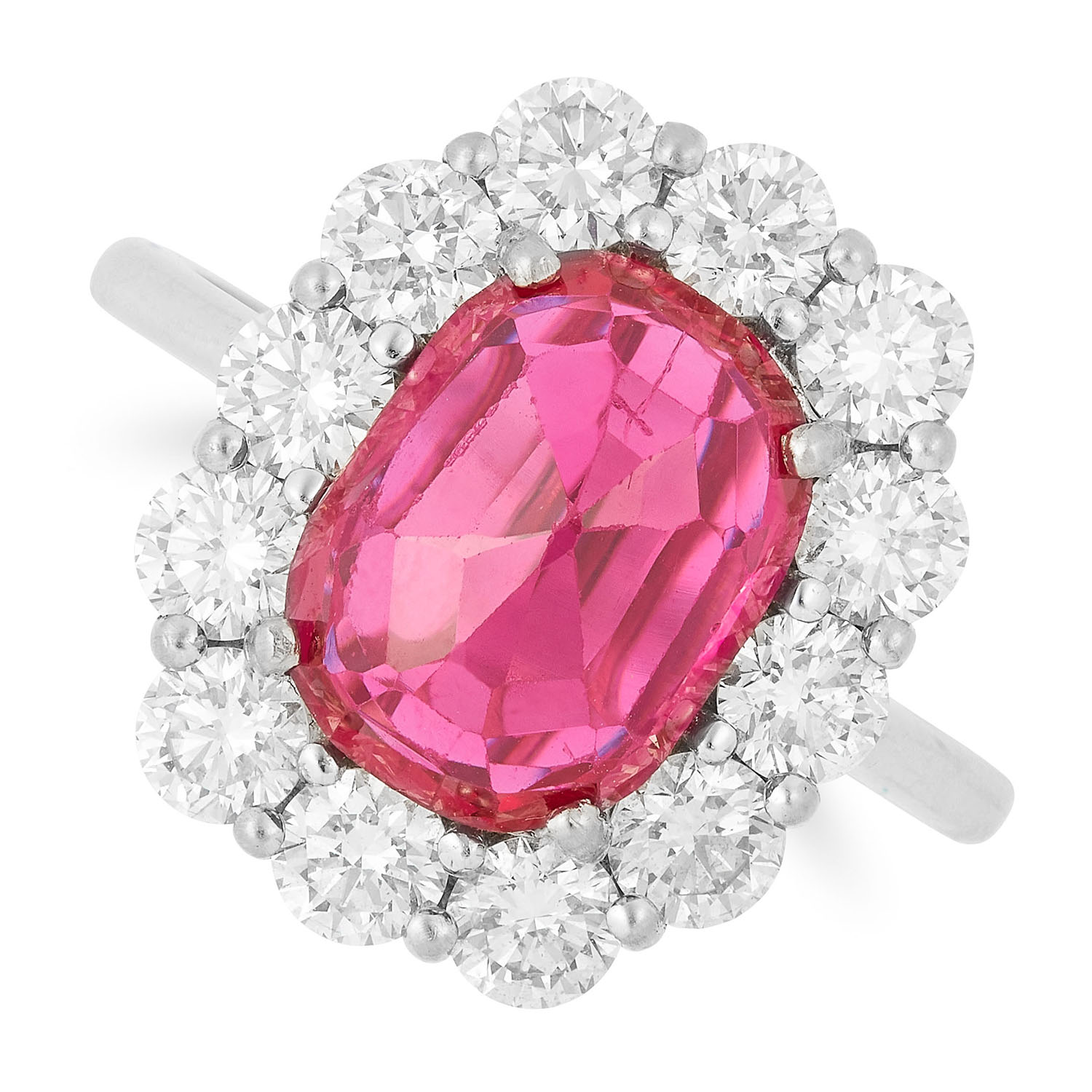 RUBY AND DIAMOND CLUSTER RING set with an oval faceted ruby in a cluster of round cut diamonds, size