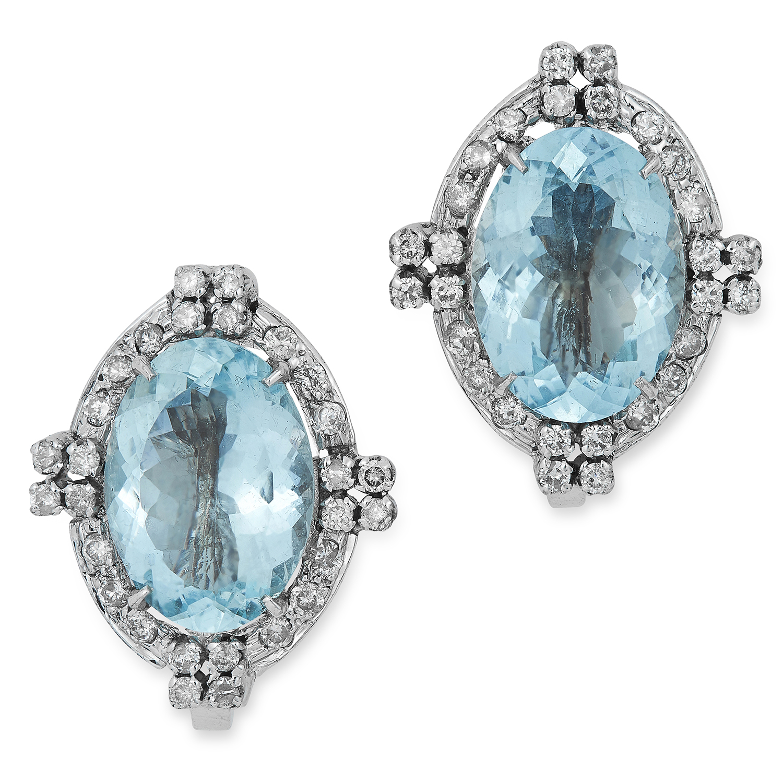 Los 42 - AQUAMARINE AND DIAMOND EARRINGS in Art Deco design, each set with an oval cut aquamarine in a border