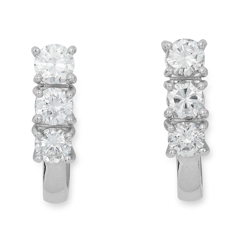 DIAMOND EARRINGS each set with three round cut diamonds, 5.7cm,